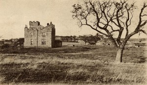Early postcard of West Hall Farm, Belford. The hollow of the moat is visible round the building.